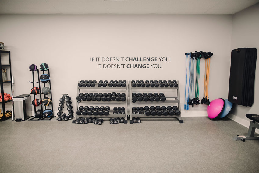 if it doesn't challenge you. i doesn't change you. quote on wall at energ fitness in new era michigan